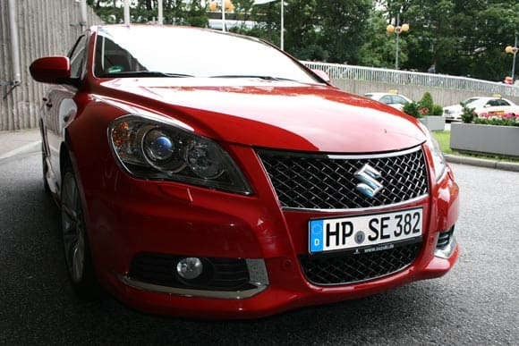 Suzuki swift black white den Splash  10
